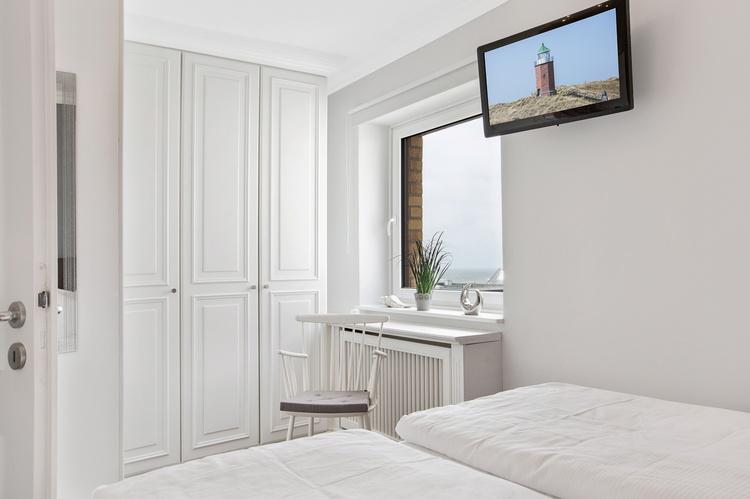ferienwohnung westerland schleswig holstein syltmomente kleiner meerblick ferienwohnung. Black Bedroom Furniture Sets. Home Design Ideas