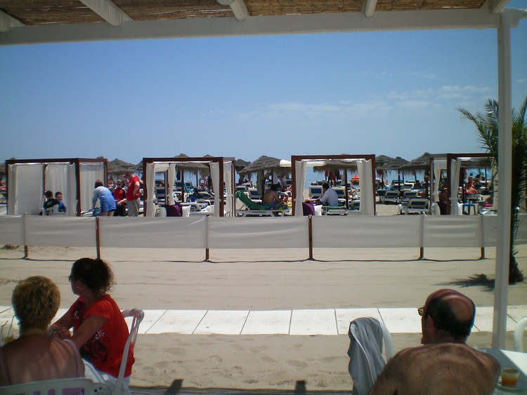 only some walk minutes away is our sandy beach with many sunbeds, bars, coffeshops and restaurants