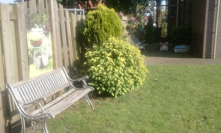 Private garden, closed, with comfortable garden furniture