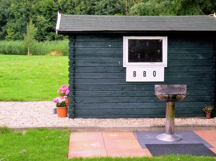 Garden shed with barbecue terrace