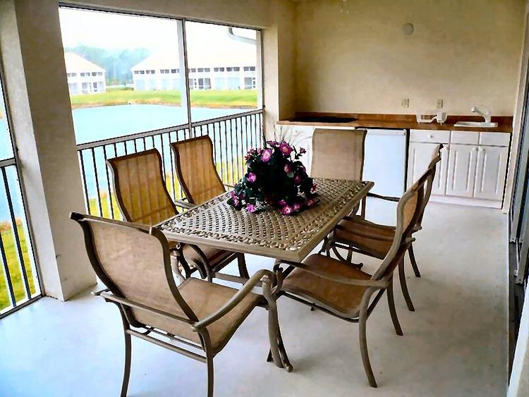 Screened Lanai, Summer kitchen, Lake view, South.