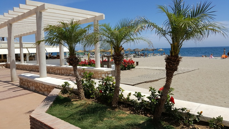only some minutes for a walk there is our always well kept sandy beach with sunbeds and restaurants