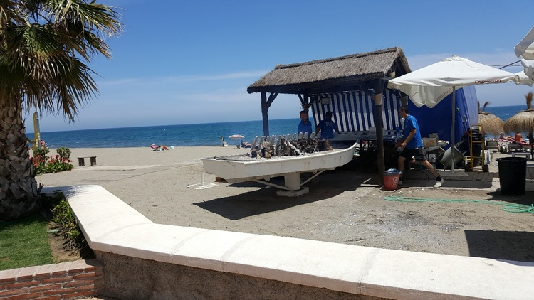 Sardines are grilled everywhere on the beach - typical of Andalusia-