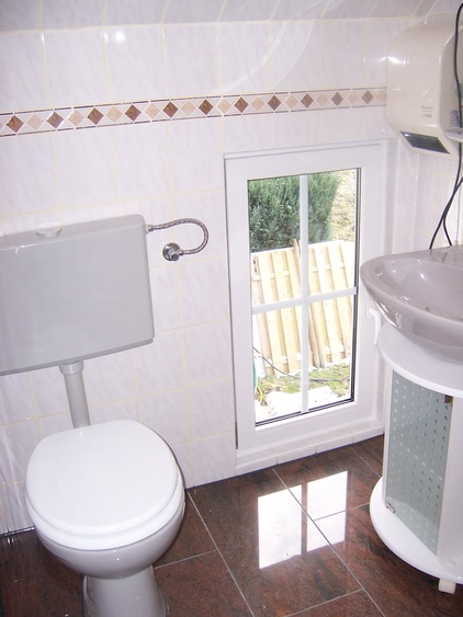 The small bathroom upstairs..