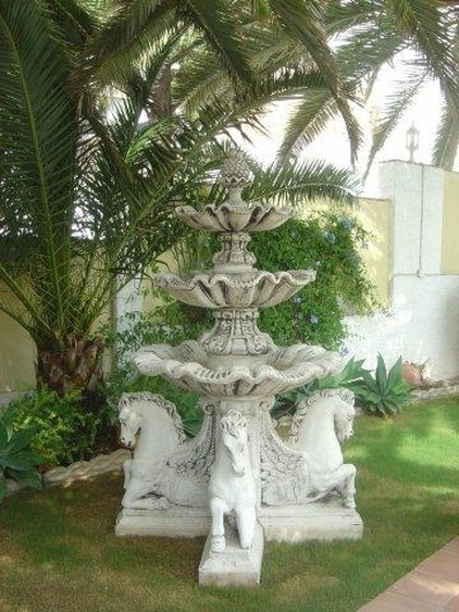 There are several fountains in the garden...