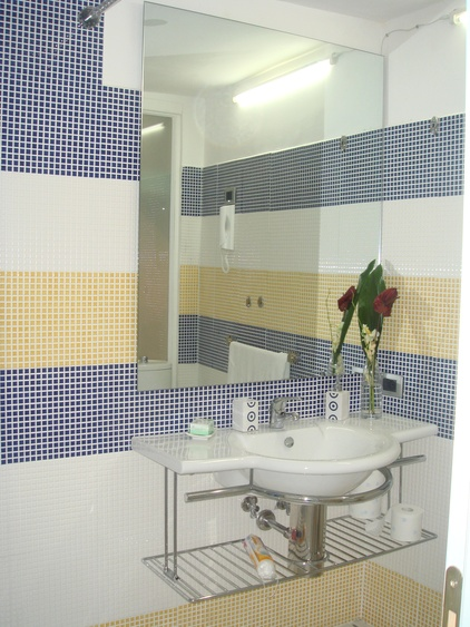 Bathroom with shower and bidet, toilet