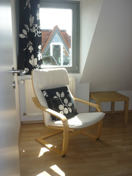 Easy chair in single room in the afternoon sun