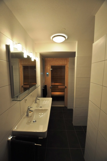 Bathroom with shower and double sinks (infra red cabin only in Ground Floor)