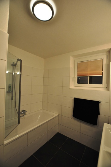 Bathroom with bath, shower and double sinks