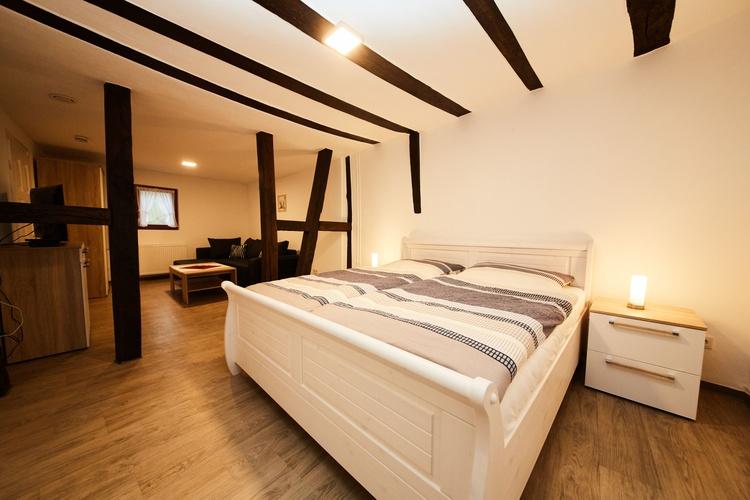 Schlafzimmer I mit Wohnecke