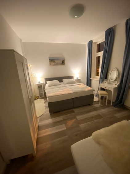 Sleeping Room with boxspringbed and cosmetic table