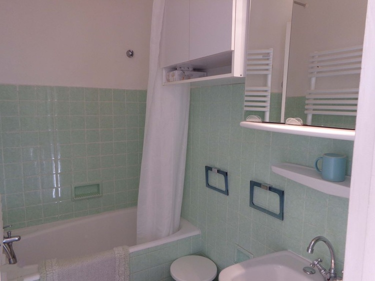 bathroom with little bath and shower, bidet and washplace