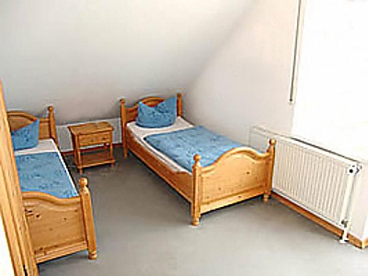 Zweites Schlafzimmer mit Ausgang zum Balkon