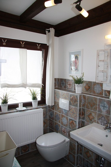Bathroom with showers