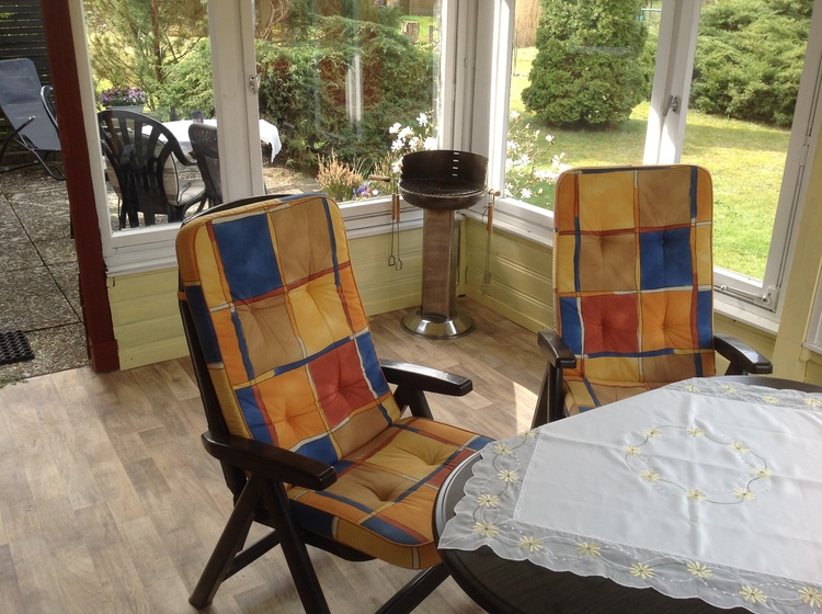 Überdachte Terrasse mit Sitzmöbel