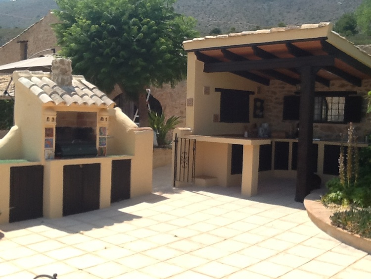 Outdoor kitchen with barbecue pool area