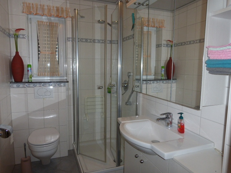 small but spacious bathroom with underfloor heating and a heated towel rail