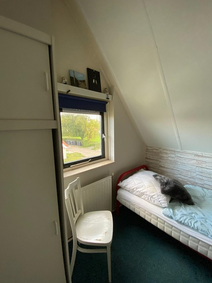 Upper floor, room with two single beds
