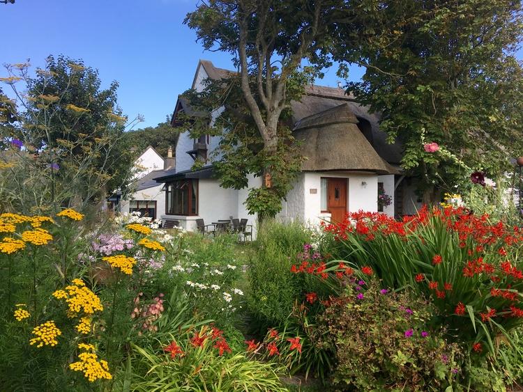 Garden Cottage with picturesque garden view.