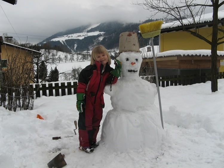 Snowman building in the garden