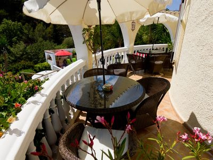 Stunning sea views from the balcony,to the pool and garden- tables + seating for up to 12 people ...